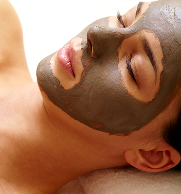 Spa. Mud Mask On The Woman's Face